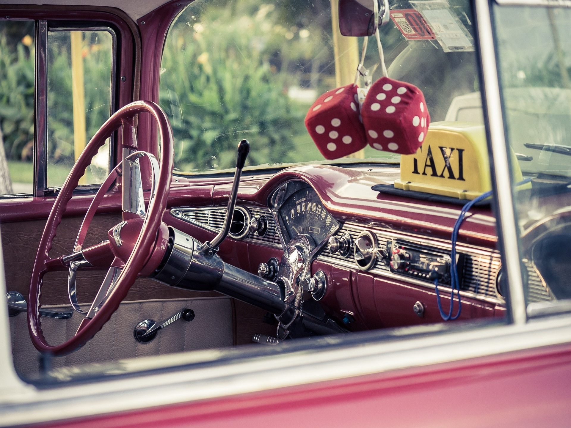 Inside of a red car with red dice in Cuba