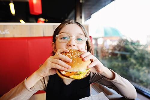 Child eating a hamburger