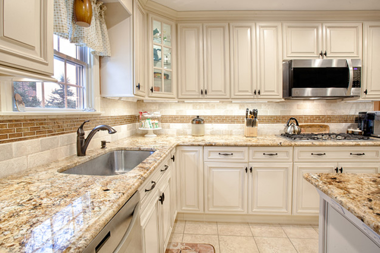 all white traditional kitchen with fabuwood wellington