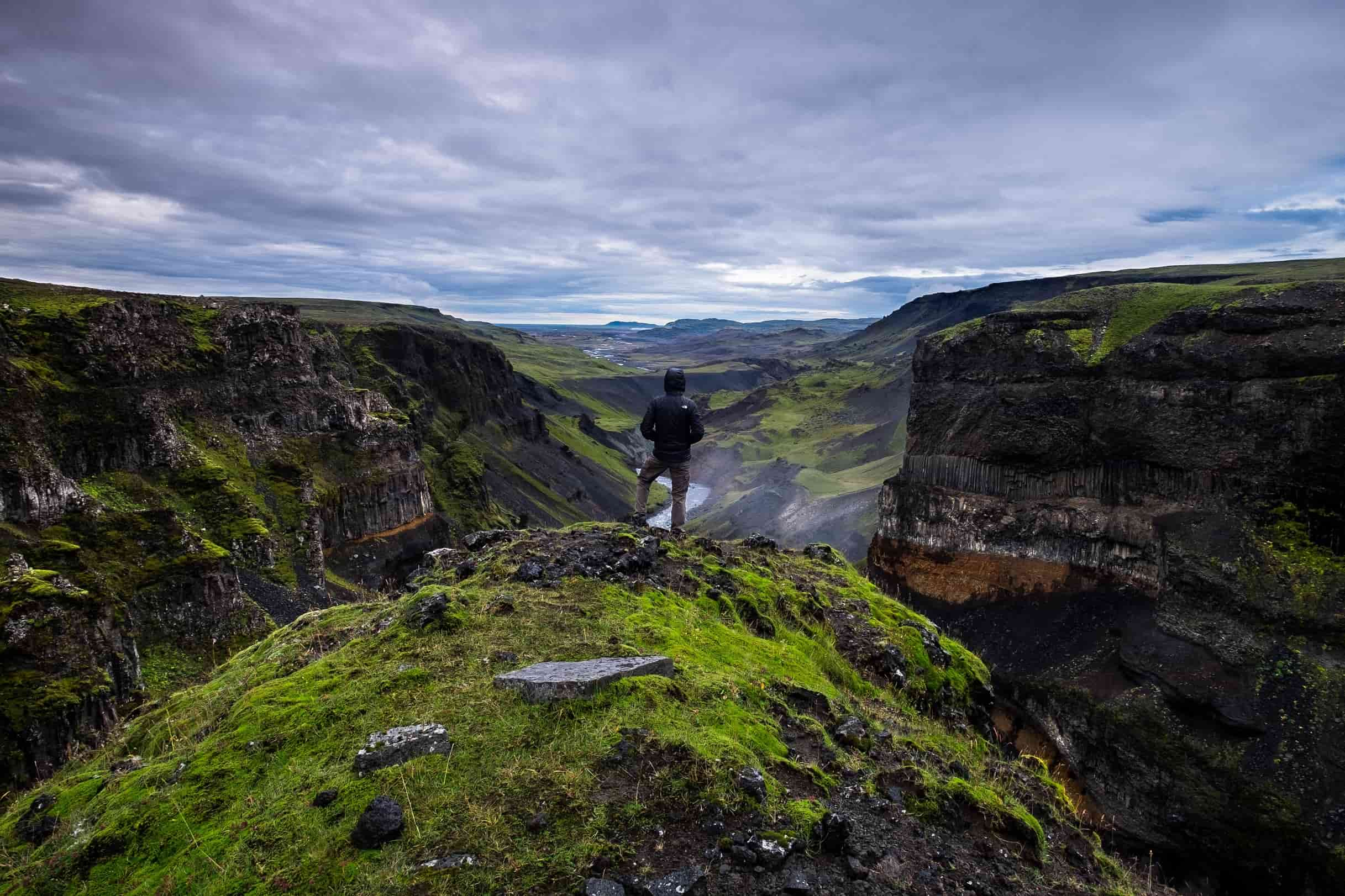 guy standing on mountain in iceland